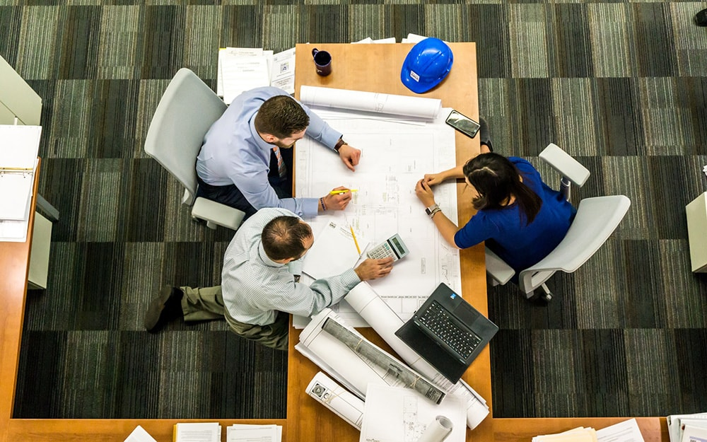 team working around table