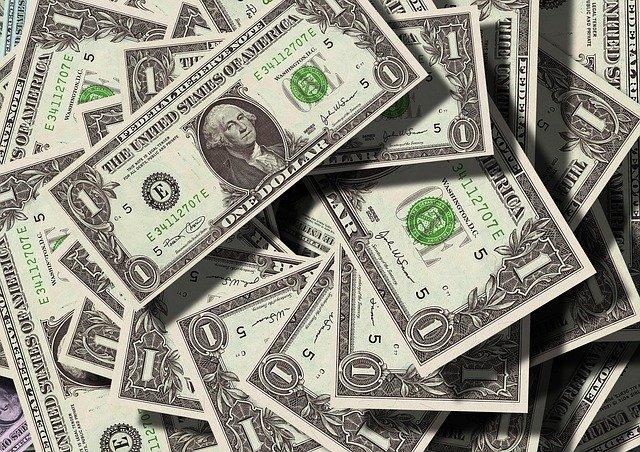 pile of 1 dollar bills