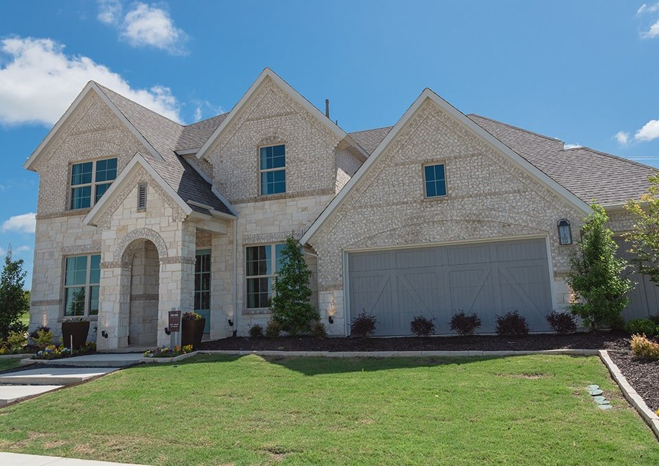 brick and stone faced home with grey trim