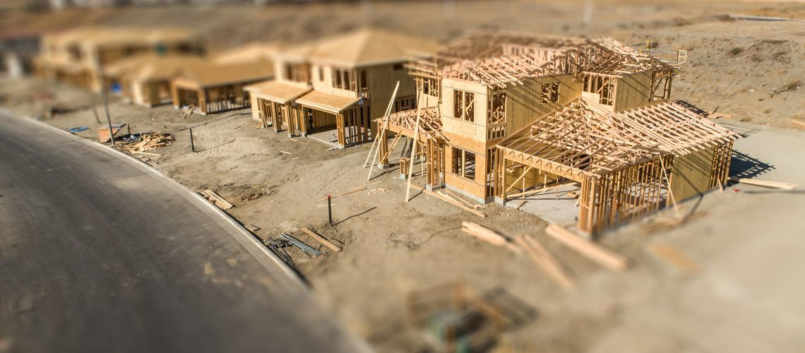 Aerial View of New Homes Construction Site with Tilt-Shift Blur.